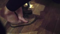 Thai Girl Wiggling Feet And Toes In Coffee House