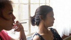 Two Thai Teens Smoking
