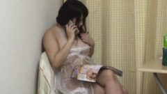 Japanese Girl Masturbaiting With Magazine In One Hand And Phone In Other
